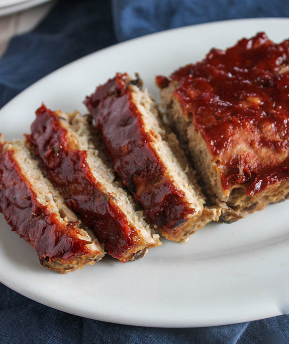 Turkey meatloaf sliced on a white plate