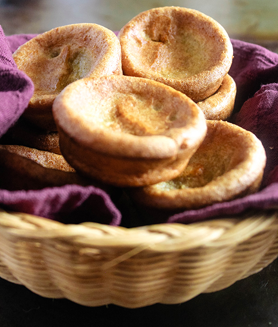 a close up of Whole wheat yorkshire puddings in a breadbasket