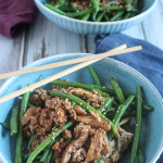 spicy green beans and pork in a blue bowl with chop sticks