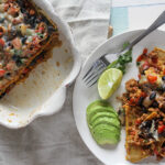 Chicken and black bean casserole in a casserole dish overhead with fork Simple and savory