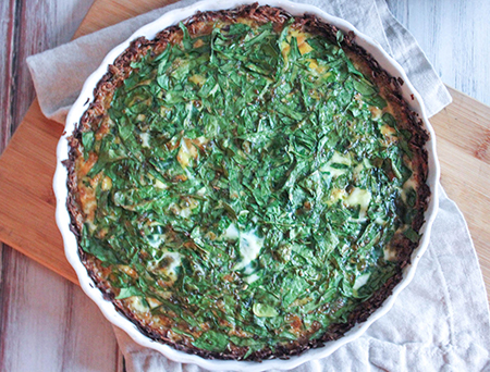 overherad view baked quiche in a pie plate