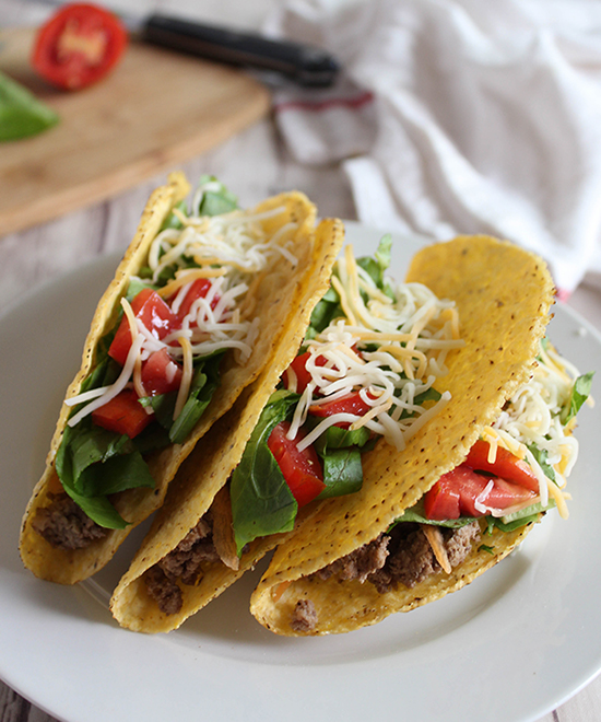 Three healthy beef tacos on a plate
