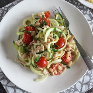 zucchini noodles with chicken on a plate