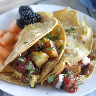 Breakfast tacos in a tortilla on a plate
