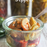 a jar of jalapeno peppers with a spoon in it