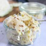 a jar overflowing with sauerkraut