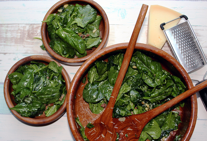Spinach basil salad with two bowls