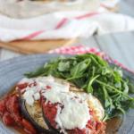 eggplant casserole on a plate with arugula