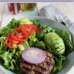 a california burger bowl filled with lettuce tomatoes and a burger