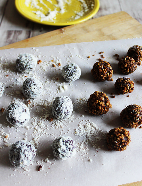 Chocolate bourbon balls are dipped in coconut and toasted pecans simple and savory