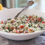 cauliflower tabbouleh salad in a bowl with a spoon