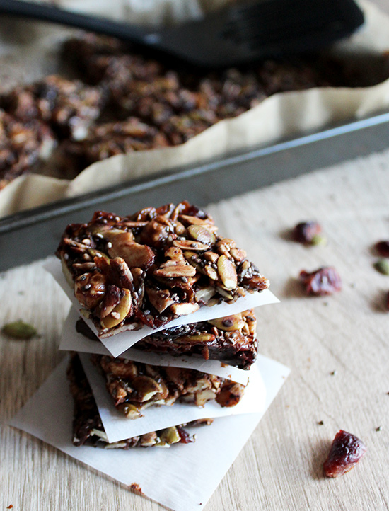Chocolate grain free granola bars stacked on a table
