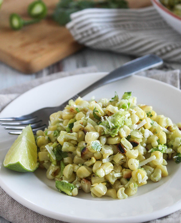 Mexican street corn salad on a plate with a fork