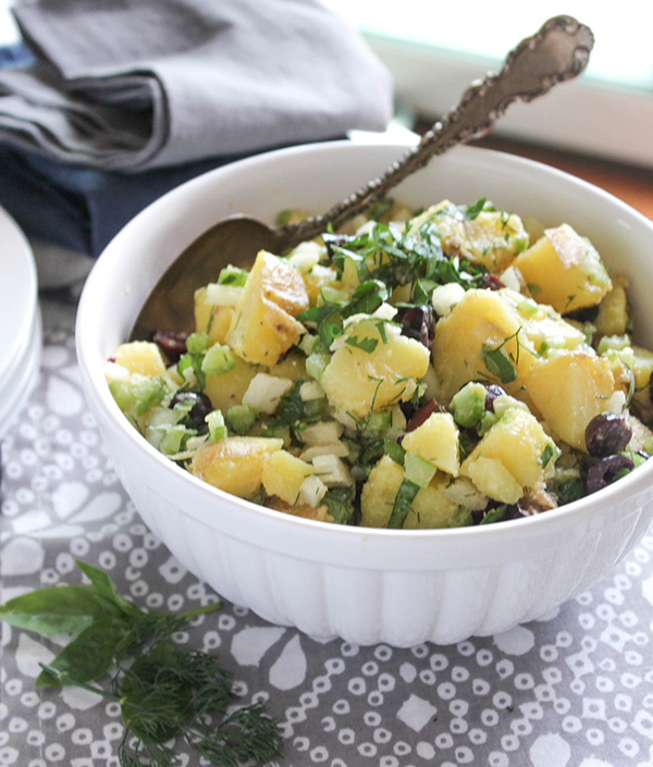 healthy potato salad in a bowl with a spoon