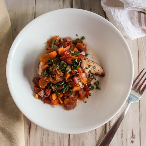 an overhead view of red wine chicken and vegetables