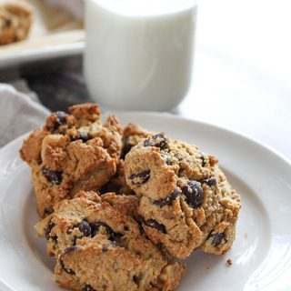 chocolate chip cookies on a plate with milk in a bottle