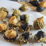 dried figs dipped in chocolate with pistachios