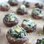 Spinach artichoke mushrooms on a baking sheet