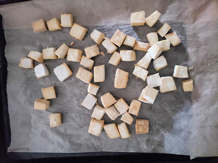 Roasted tofu on a baking sheet