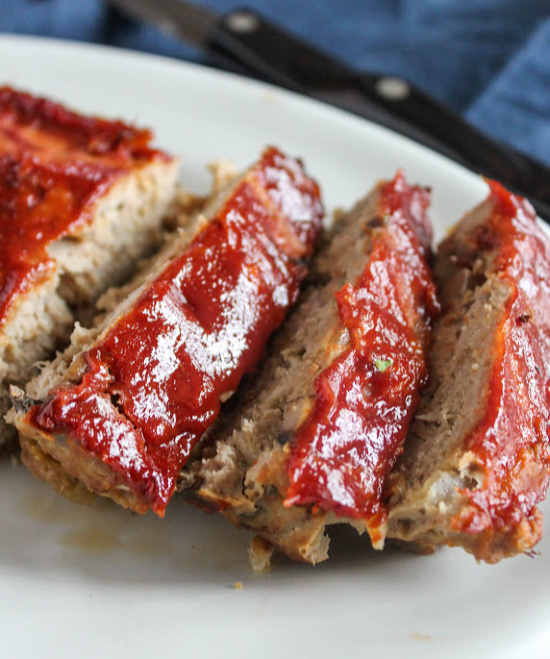 a close up of meatloaf slices on a plate
