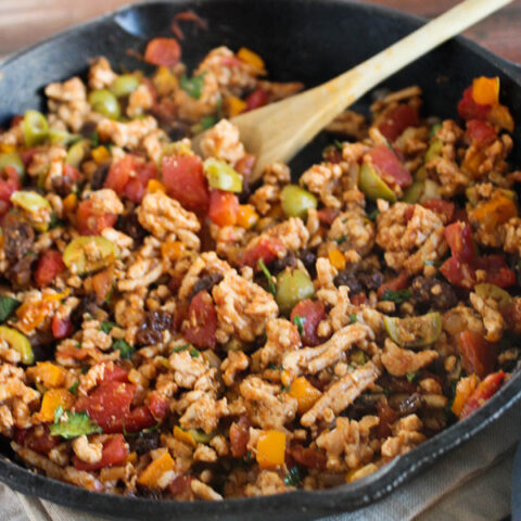 chicken picadillo in a cast iron pan