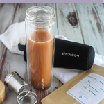 chai latte in a water bottle with a diffuser and a bag of tea