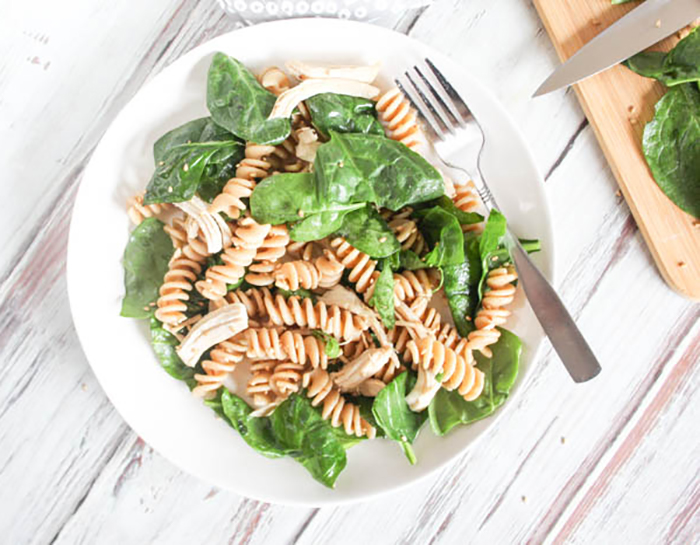 overhead view of pasta salad on a white plate