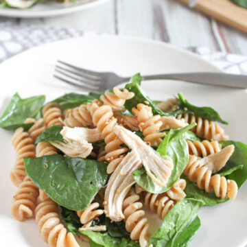 spinach pasta salad on a plate