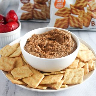 Snickerdoodle hummus i a bowl with sweet cornbread crisps