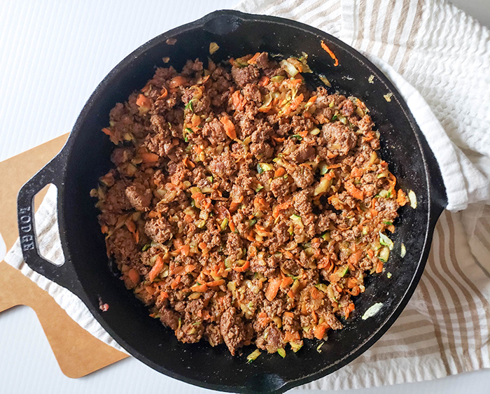 an-overhead-view-of-the-finished-taco-meat-with-vegetables