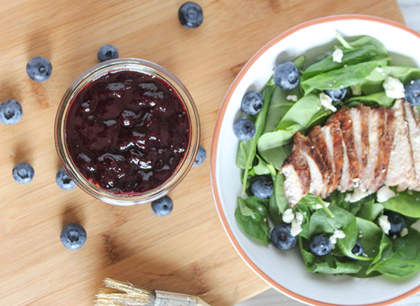blueberry barbecue sauce with chicken in a salad