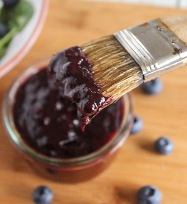 blueberry barbecue sauce on a pastry brush