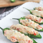 grilled jalapeno poppers arranged on a white dish