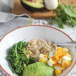 eggs, sauteed greens, avocado and oatmeal in a bowl