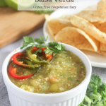 roasted tomatillo salsa verde in a bowl with a side of chips