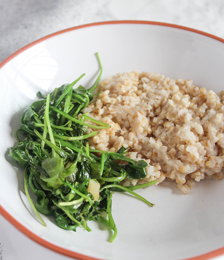 arugula and whole grains in a bowl