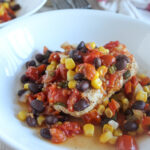 slow cooked southwest chicken with corn and beans in a bowl