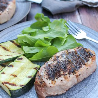 Pork chop on a plate with veggies