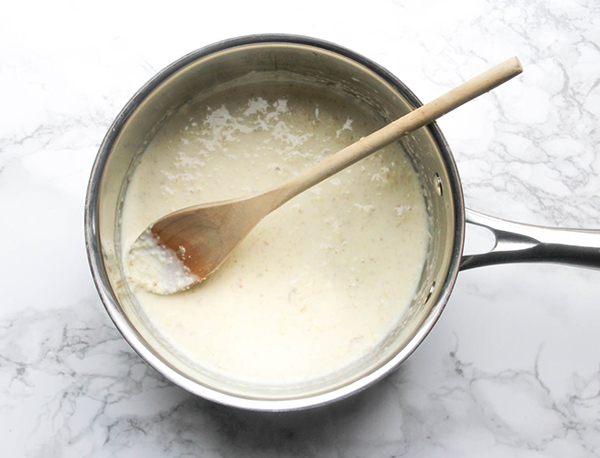Coconut milk with garlic and ginger in a pan