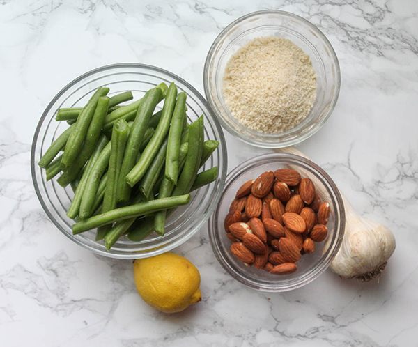 the ingredients: Green beans, almonds, bread crumbs, garlic, and lemon in little bowls