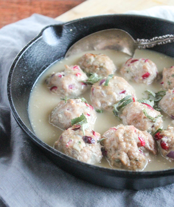 turkey meatballs covered with gravy in a skillet