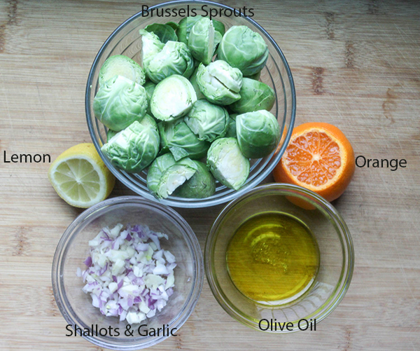 Brussels sprouts lemon orange shallots olive oil - the ingredients for easy roasted Brussles Sprouts