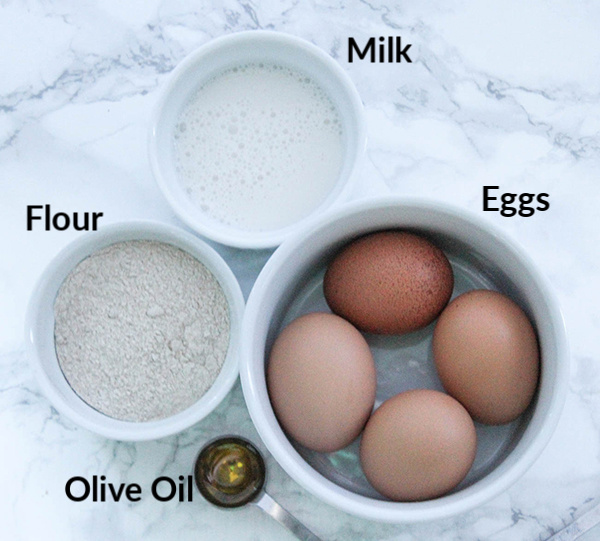 The ingredients- flour, milk, eggs and olive oil