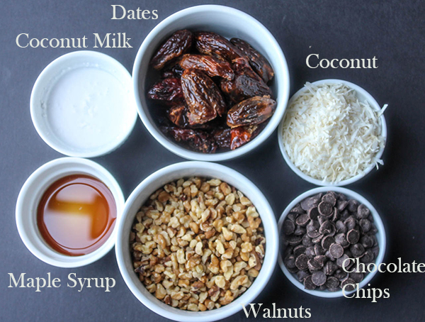 Dates, coconut milk, maple syrup, walnuts chocolate chips and coconut the ingredients for magic cookie bars