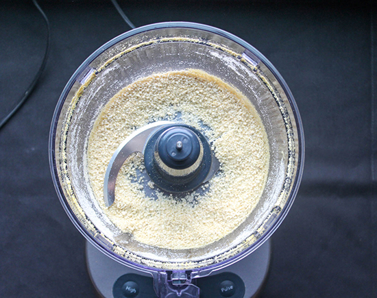 cashews and nutritional yeast that have been ground up in a food processor