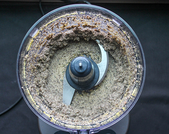 ground up cashews yeast and mushrooms in a food processor