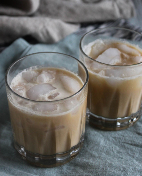 two glasses filled with coffee and cream