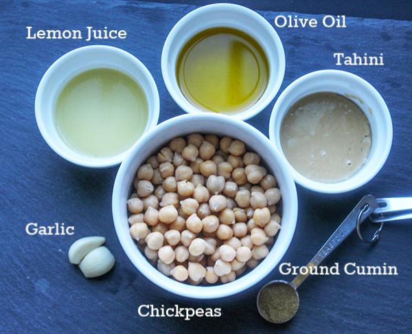 The hummus ingredients, lemon juice, olive oil, tahnin, ground cumin, chickpeas, garlic