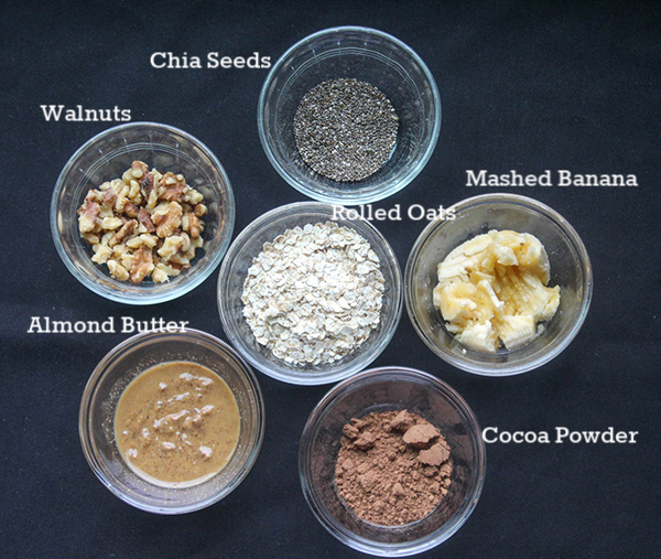 The ingredients; chia seeds, walnuts, rolled oats, banana, almond butter and cocoa powder