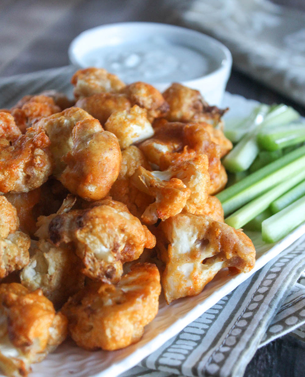 a close up view of buffalo cauliflower bites on a plate